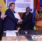 USAID/Ghana Mission Director, Andy Karas exchanges the MOU with the director of Social Welfare