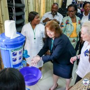 Melinda Tabler-Stone, Chargee d'Affairs of the US Embassy in Accra using a Veronica bucket to wash her hands at the launch event