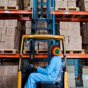 A worker lifts a pallet onto the vertical racking system in a Pharmaceutical Fund and Supply Agency warehouse in Kality.