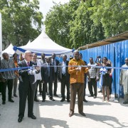 Ghana's Vice President Amissah-Arthur and USAID Assistant Administrator Linda Etim cutting the ribbon to inaugurate the building