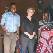 Mission Director Riley visits a program beneficiary's sewing workshop