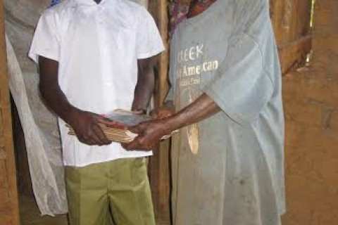 A grandmother readies her grandson for school
